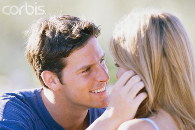 Man Touching Woman's Face
